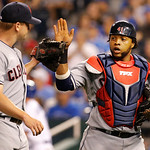 Cleveland Indians relief pitcher Vinnie Pestano, left, is congratulated by catcher Carlos Santana during the eighth inning of a baseball game against the Kansas City Royals at Kauffman Stadi …