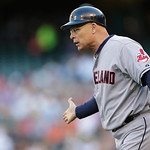 Cleveland Indians third base coach Brad Mills waits for a baserunner during a baseball game against the Seattle Mariners , Monday, July 22, 2013, in Seattle. (AP Photo/Ted S. Warren)