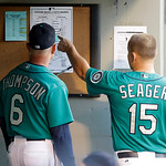 Seattle Mariners bench coach Robby Thompson (6) looks at the lineup sheet with Mariners' Kyle Seager (15) during the third inning of a baseball game against the Cleveland Indians, Monday, Ju …