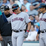 Cleveland Indians' Asdrubal Cabrera, center, holds up his right arm as he stands on first base next to Indians first base coach Mike Sarbaugh, right, after Cabrera was hit by a pitch in the  …