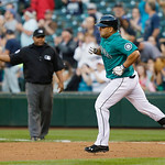 Seattle Mariners' Kendrys Morales 'rounds the bases after hitting a home run in the fourth inning of a baseball game against the Cleveland Indians, Monday, July 22, 2013, in Seattle. (AP Pho …