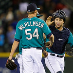 Seattle Mariners' Mike Zunino, right, greets closer Tom Wilhelmsen (54), after the Mariners beat the Cleveland Indians 2-1 in a baseball game, Monday, July 22, 2013, in Seattle. (AP Photo/Te …