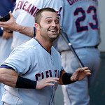 Cleveland Indians' Nick Swisher reacts in the dugout after he hit a solo home run against the Seattle Mariners in the first inning of a baseball game, Monday, July 22, 2013, in Seattle. (AP  …