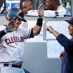 Cleveland Indians' Nick Swisher, left, is greeted in the dugout by Indians manager Terry Francona, right, after Swisher hit a solo home run against the Seattle Mariners in the first inning o …