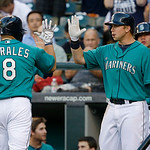 Seattle Mariners' Kendrys Morales (8) is greeted by Mariners' Justin Smoak, right, after Morales hit a home run in the fourth inning of a baseball game against the Cleveland Indians, Monday, …