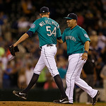 Seattle Mariners' Kendrys Morales, right, greets closer Tom Wilhelmsen (54) after the Mariners beat the Cleveland Indians 2-1in a baseball game, Monday, July 22, 2013, in Seattle. (AP Photo/ …