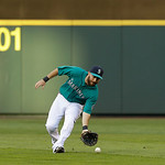 Seattle Mariners outfielder Dustin Ackley makes a play during a baseball game against the Cleveland Indians, Monday, July 22, 2013, in Seattle. (AP Photo/Ted S. Warren)
