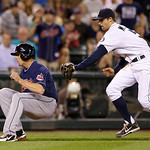 Seattle Mariners shortstop Brad Miller, right, tags out Cleveland Indians' Drew Stubbs after Stubbs was caught between home and third in the ninth inning of a baseball game Tuesday, July 23, …