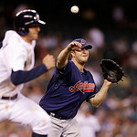 Cleveland Indians relief pitcher Matt Albers, right, throws to first on a grounder by Seattle Mariners' Brad Miller in the sixth inning of a baseball game Tuesday, July 23, 2013, in Seattle. …