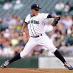 Seattle Mariners staring pitcher Erasmo Ramirez throws against the Cleveland Indians in the first inning of a baseball game Tuesday, July 23, 2013, in Seattle. (AP Photo/Elaine Thompson)