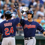 Cleveland Indians' Yan Gomes, right, is greeted by Michael Bourn hitting a two-run home run against the Seattle Mariners in the second inning of a baseball game Tuesday, July 23, 2013, in Se …
