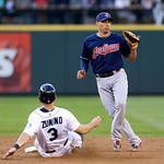 Cleveland Indians shortstop Asdrubal Cabrera, right, waits for the ball as Seattle Mariners' Mike Zunino slides toward second base in a baseball game Tuesday, July 23, 2013, in Seattle. (AP  …