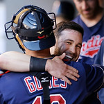 Cleveland Indians' Jason Kipnis, right, is hugged by catcher Yan Gomes after scoring against the Seattle Mariners in the first inning of a baseball game Tuesday, July 23, 2013, in Seattle. ( …