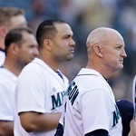 Seattle Mariners bench coach Robby Thompson, right, stands for the national anthem with players before a baseball game against the Cleveland Indians Tuesday, July 23, 2013, in Seattle. Thomp …