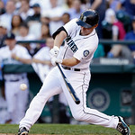 Seattle Mariners' Kyle Seager drives in a run with a double against the Cleveland Indians in the first inning of a baseball game Tuesday, July 23, 2013, in Seattle. (AP Photo/Elaine Thompson …