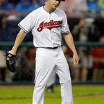 Cleveland Indians starting pitcher Scott Kazmir reacts after giving up a solo home run to Detroit Tigers' Matt Tuiasosopo  in the fourth inning of a baseball game Monday, July 8, 2013, in Cl …