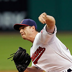 Cleveland Indians starting pitcher Scott Kazmir delivers against the Detroit Tigers in the first inning of a baseball game Monday, July 8, 2013, in Cleveland. (AP Photo/Mark Duncan)