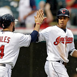 Cleveland Indians' Mike Aviles (4) celebrates with Michael Brantley after both scored on a single by Lonnie Chisenhall in the second inning of a baseball game against the Detroit Tigers Mond …