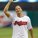 Former Cleveland Indians shortstop Omar Vizquel waves to the crowd before throwing a ceremonial pitch before a baseball game against the Detroit Tigers Monday, July 8, 2013, in Cleveland. (A …