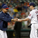 Cleveland Indians manager Terry Francona, left, takes the ball from starting pitcher Scott Kazmir in the sixth inning of a baseball game against the Detroit Tigers Monday, July 8, 2013, in C …