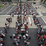 Fans line up early outside the gates at Progressive Field before a baseball game between the Detroit Tigers and the Cleveland Indians Monday, July 8, 2013, in Cleveland. The first 10,000 fan …