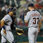 Detroit Tigers catcher Brayan Pena comes to the mound to talk with starting pitcher Max Scherzer (37) as rain falls in the second inning of a baseball game Monday, July 8, 2013, in Cleveland …