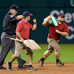 Crew chief Joe West (22) directs the grounds crew during a pithing change in the sixth inning of a baseball game between the Detroit Tigers and the Cleveland Indians Monday, July 8, 2013, in …