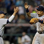 Detroit Tigers' Miguel Cabrera (24) celebrates with Victor Martinez (41) after a 4-2 win in 10 innings over the Cleveland Indians in a baseball game Monday, July 8, 2013, in Cleveland. Marti …