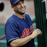 Cleveland Indians John McDonald smiles in the dugout during the first inning of a baseball game against the Texas Rangers on Tuesday, June 11, 2013, in Arlington, Texas. McDonald has rejoine …