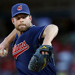 Cleveland Indians starting pitcher Corey Kluber (28) throws during the first inning of a baseball game against the Texas Rangers Tuesday, June 11, 2013, in Arlington, Texas. (AP Photo/LM Ote …