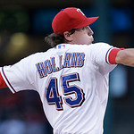 Texas Rangers starting pitcher Derek Holland (45)  throws during the first inning of a baseball game against the Cleveland Indians Tuesday, June 11, 2013, in Arlington, Texas. (AP Photo/LM O …