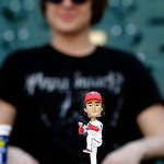 A Texas Rangers starting pitcher Yu Darvish bobble head handed out to fans sits atop the dugout before the baseball game between the Cleveland Indians and Texas Rangers Tuesday, June 11, 201 …