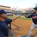 Cleveland Indians Mike Aviles, right, gets a congrats from manager Terry Francona after he scored during the baseball game against the Cleveland Indians Tuesday, June 11, 2013, in Arlington, …