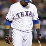 Texas Rangers Nelson Cruz looks down and holds a broken bat during the eighth inning of a baseball game against the Cleveland Indians Wednesday, June 12, 2013, in Arlington, Texas. The India …