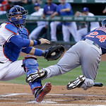 Texas Rangers catcher A.J. Pierzynski, left, tags out Cleveland Indians' Michael Bourn (24) at home plate during the first inning of a baseball game on Wednesday, June 12, 2013, in Arlington …