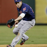 Cleveland Indians second baseman Jason Kipnis (22) catches a grounder during the baseball game against the Texas Rangers Wednesday, June 12, 2013, in Arlington, Texas. (AP Photo/LM Otero)
