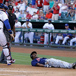 Cleveland Indians  Michael Bourn (24) lays on the ground after Texas Rangers catcher A.J. Pierzynski (12) tagged him out at home plate during the first inning of a baseball game Wednesday, J …