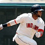 Cleveland Indians' Carlos Santana singles to drive in a run against the Washington Nationals in the fourth inning of a baseball game on Sunday, June 16, 2013, in Cleveland. (AP Photo/Mark Du …