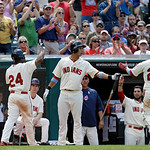 Cleveland Indians' Michael Brantley, center, greets Jason Kipnis (22) and Michael Bourn (24) after Bourne scored on Kipnis' sacrifice fly in the eighth inning of a baseball game against the  …