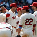 Cleveland Indians pitching coach Mickey Callaway, second from left, meets starting pitcher Corey Kluber, right, and the infield on the mound in the seventh inning of a baseball game against  …