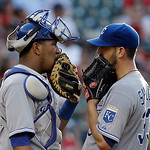 Kansas City Royals catcher Salvador Perez, left, confers with starting pitcher James Shields in the third inning of a baseball game against the Cleveland Indians Monday, June 17, 2013, in Cl …