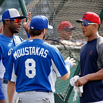Cleveland Indians' Michael Brantley, right, talks with Kansas City Royals' Lorenzo Cain, left, and Mike Moustakas (8) before a baseball game Monday, June 17, 2013, in Cleveland. (AP Photo/Ma …