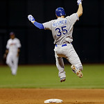 Kansas City Royals' Eric Hosmer leaps over the throw from the outfield as he goes into second with an RBI double in the seventh inning of a baseball game against the Cleveland Indians Monday …