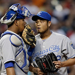 Kansas City Royals catcher Salvador Perez, left, confers with relief pitcher Bruce Chen in the seventh inning of a baseball game against the Cleveland Indians Monday, June 17, 2013, in Cleve …