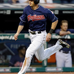 Cleveland Indians' Drew Stubbs races home to score on a single by Mike Aviles in the sixth inning of a baseball game against the Kansas City Royals Tuesday, June 18, 2013, in Cleveland. (AP  …