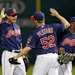 Cleveland Indians' Drew Stubbs, left, and Michael Bourn, right, congratulate relief pitcher Vinnie Pestano (52) after a 4-3 win over the Kansas City Royals in a baseball game Tuesday, June 1 …