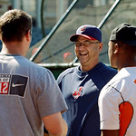 Cleveland Indians manager Terry Francona, second from right, talks with Cleveland Browns rookies Braxton Cane, left, Jamoris Slaughter, right, and Browns' staffer Aaron Shea before a basebal …