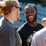 Cleveland Browns linebacker Barkevious Mingo, right, talks with offensive lineman Garrett Gilkey as they watch the Cleveland Indians take batting practice Tuesday, June 18, 2013, in Clevelan …