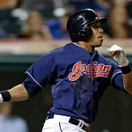 Cleveland Indians' Michael Brantley watches his sacrifice fly off Kansas City Royals relief pitcher Tim Collins to drive in Mike Aviles with the go-ahead run in the eighth inning of a baseba …