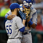 Kansas City Royals catcher Salvador Perez talks to relief pitcher Tim Collins (55) in the sixth inning of a baseball game against the Cleveland Indians Wednesday, June 19, 2013, in Cleveland …